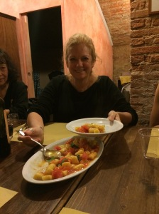 Me serving gnocchi with tomato garlic sauce